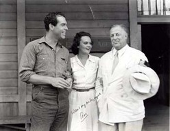 Actor Fred MacMurray, Ann Cottrell (Free) and Hollywood producer Edward H. Griffith on the set of